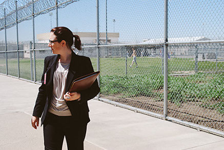 Anna Guy, attorney at Disability Rights Washington, stands outside of Stafford Creek Corrections Center during a monitoring visit.